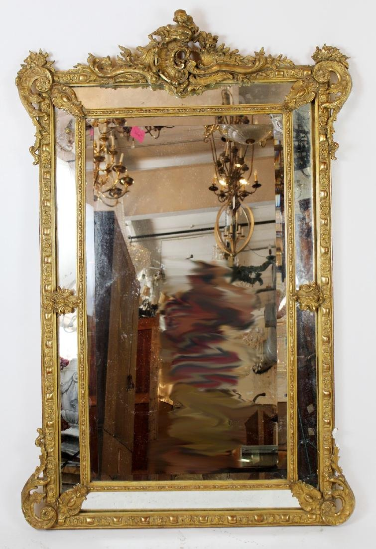 Louis XV gilt mirror with focal crest