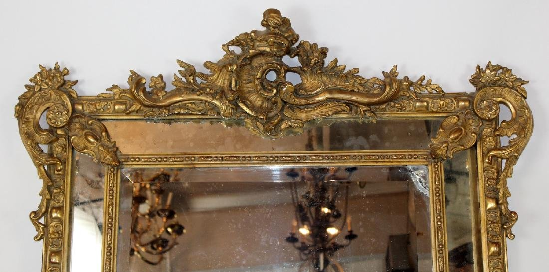 Louis XV gilt mirror with focal crest - 3