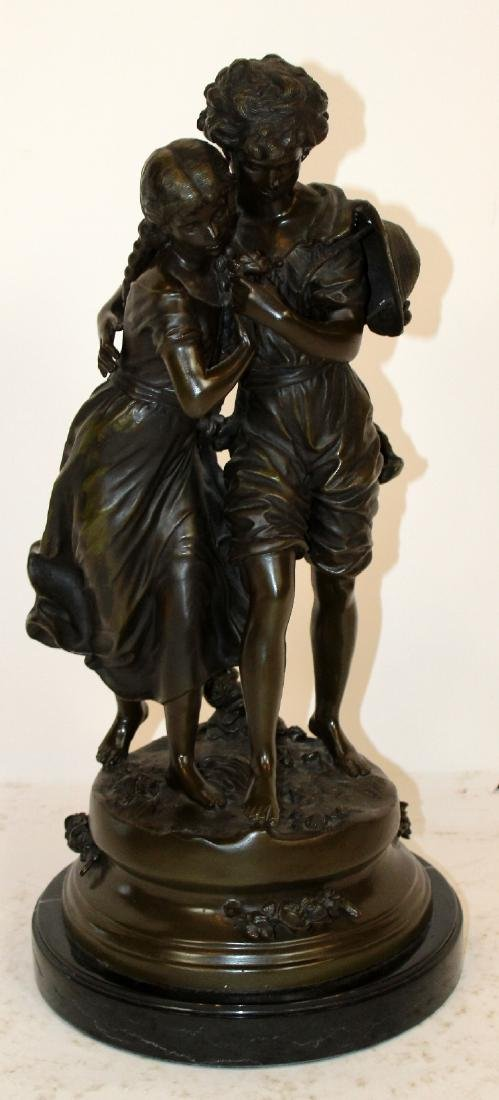 Bronze statue of young couple