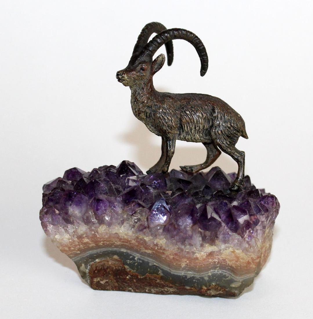 Miniature bronze ram on amethyst geode