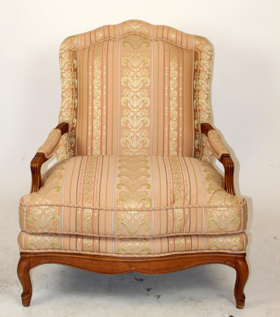 Baker open side arm chair with pink upholstry.