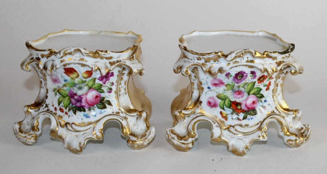 Pair of floral porcelain stands