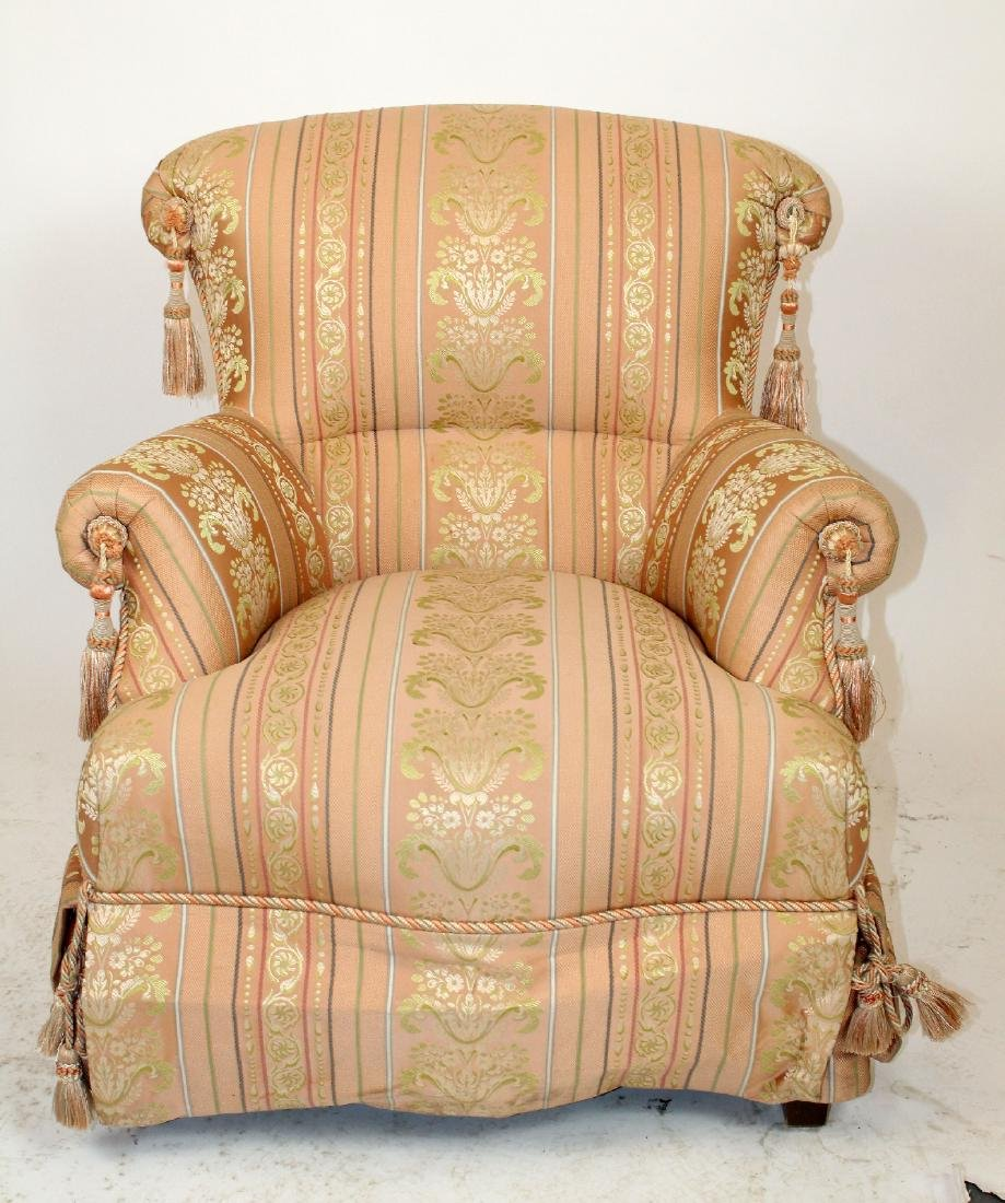 Baker pink upholstered rolled arm chair.