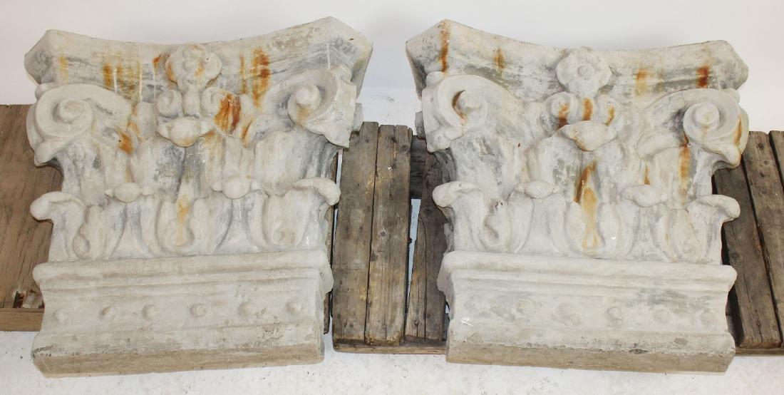 Pair of cast Corinthian capitals