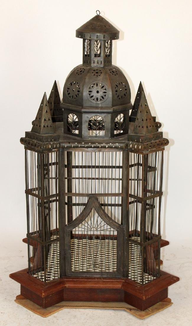 Pressed tin birdcage with turrets