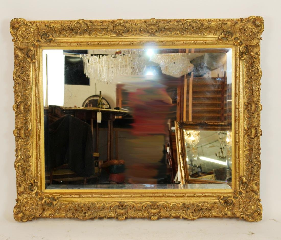 Gilt framed beveled mirror