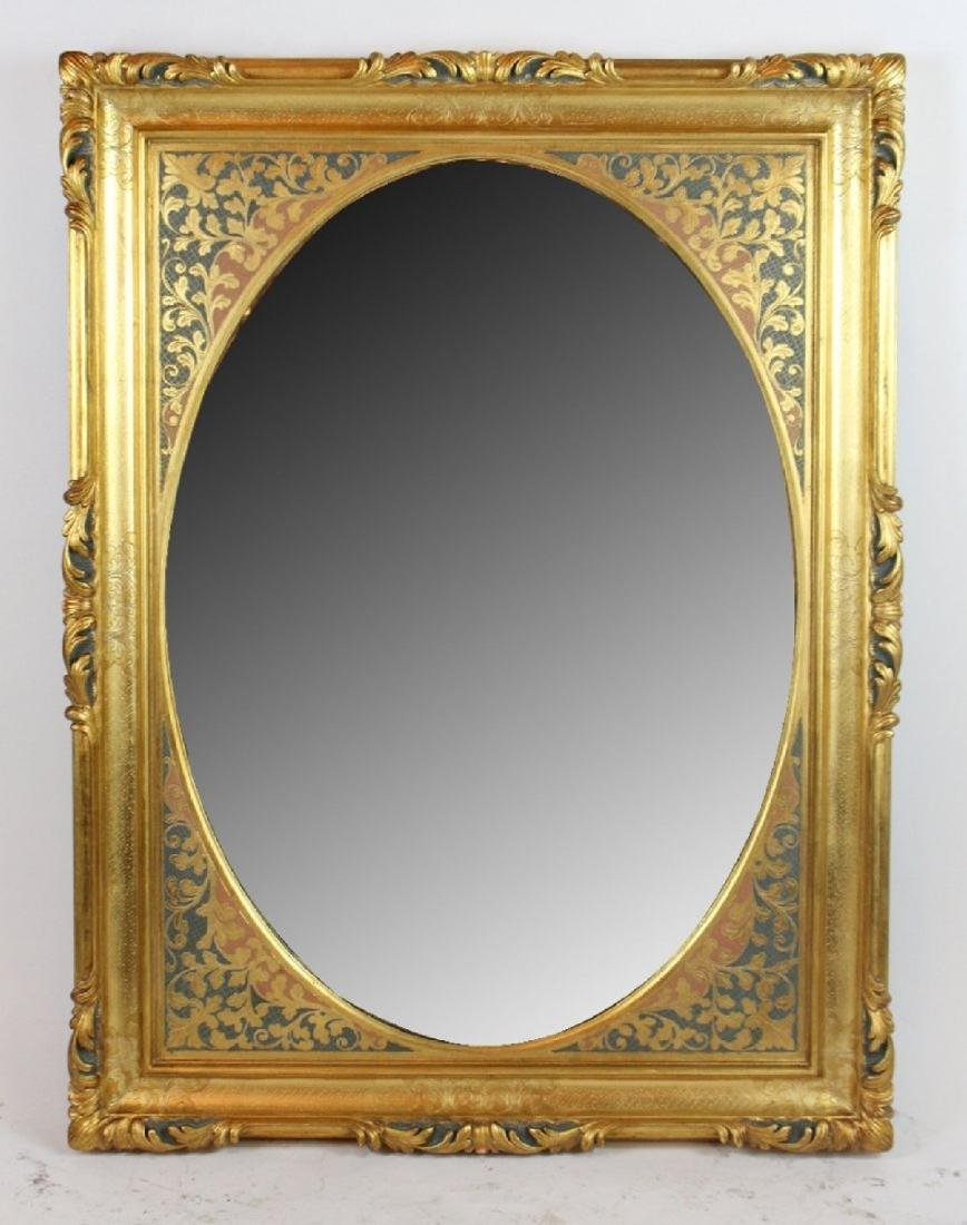 Gilt framed mirror with foliate border