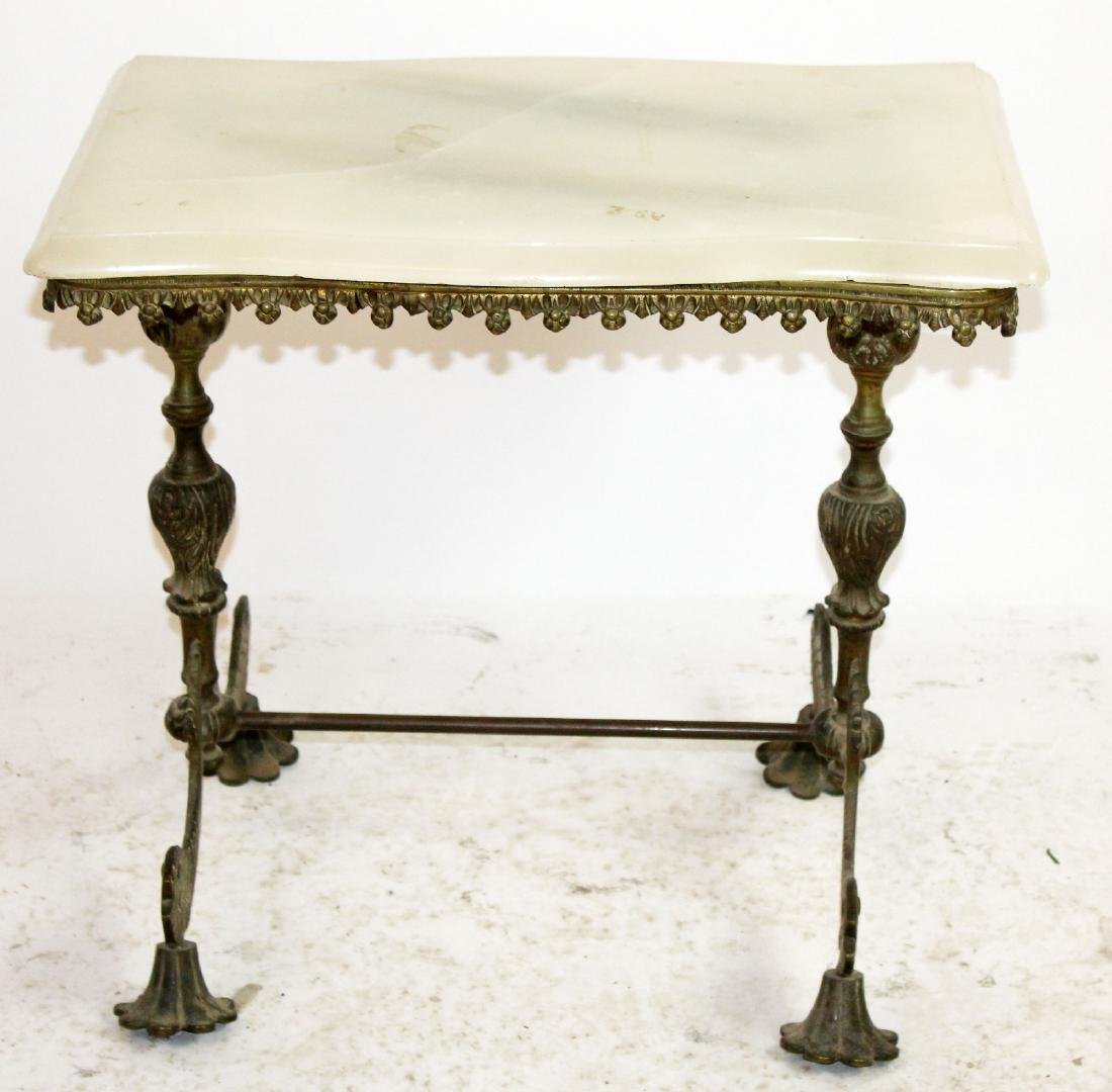 American brass onyx top table with fish