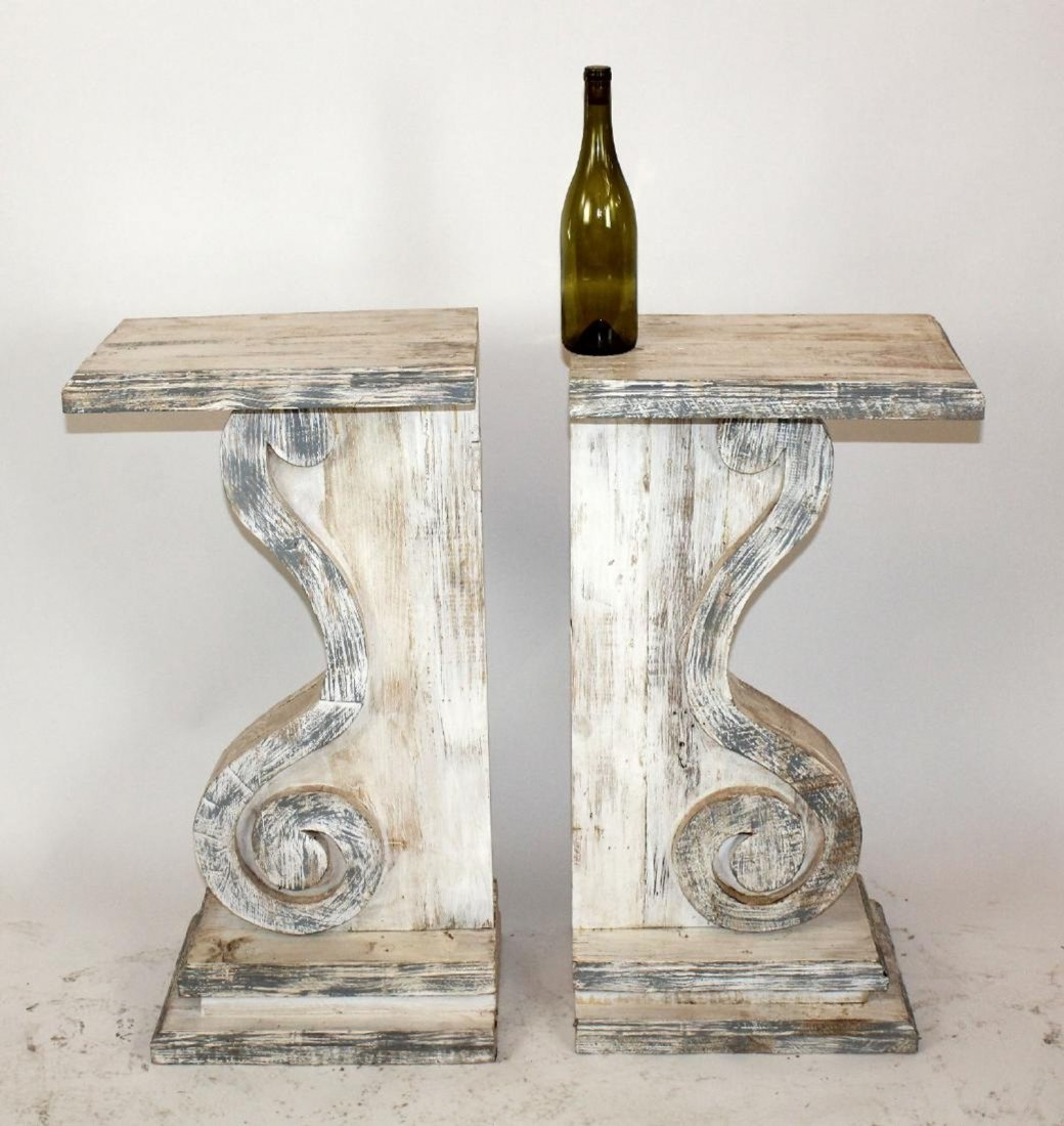 Pair of distressed painted carved corbels
