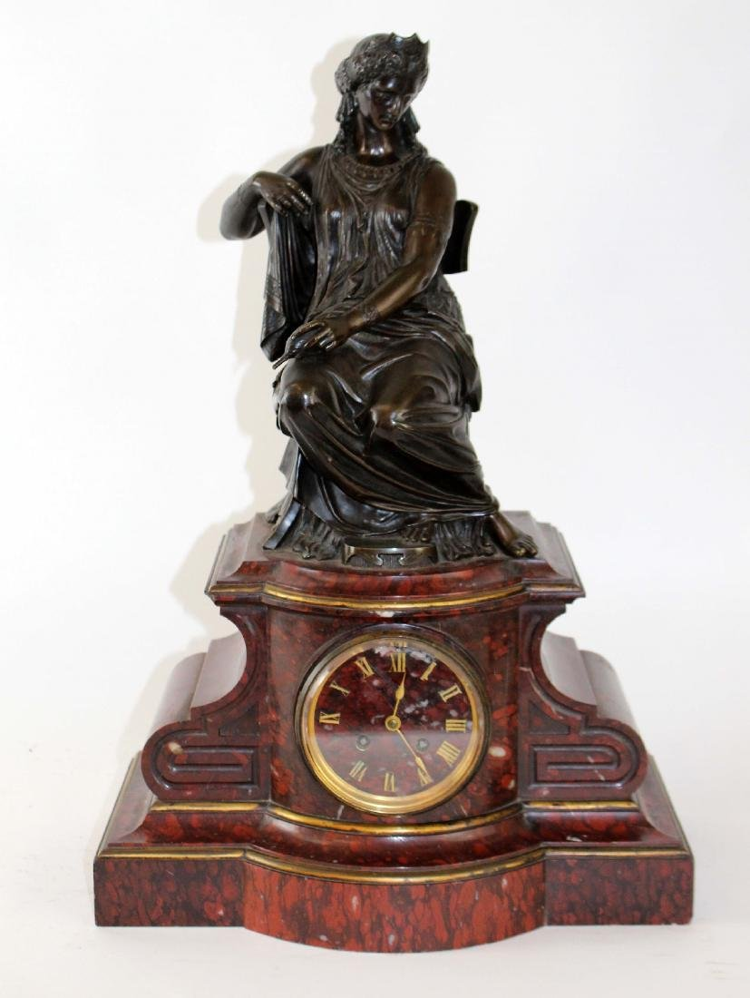 French figural mantel clock with a bronze seated lady