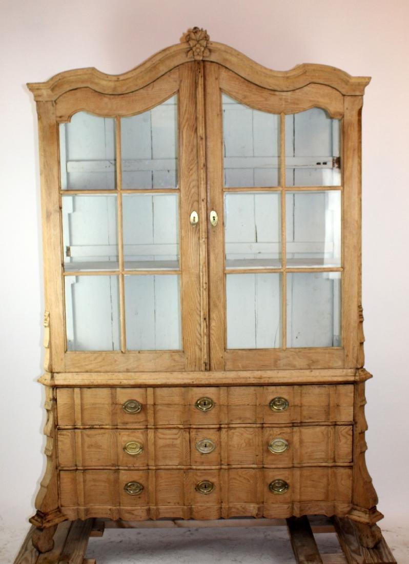 Dutch vitrine with paned glass upper doors