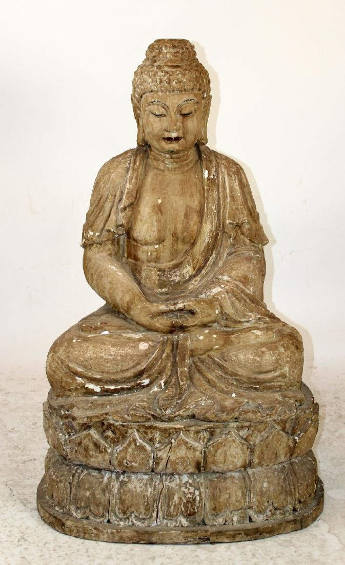 Carved wooden seated Buddha on lotus