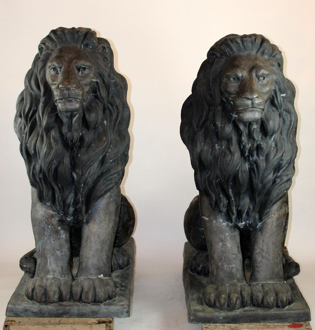 Pair of giant bronze seated lions