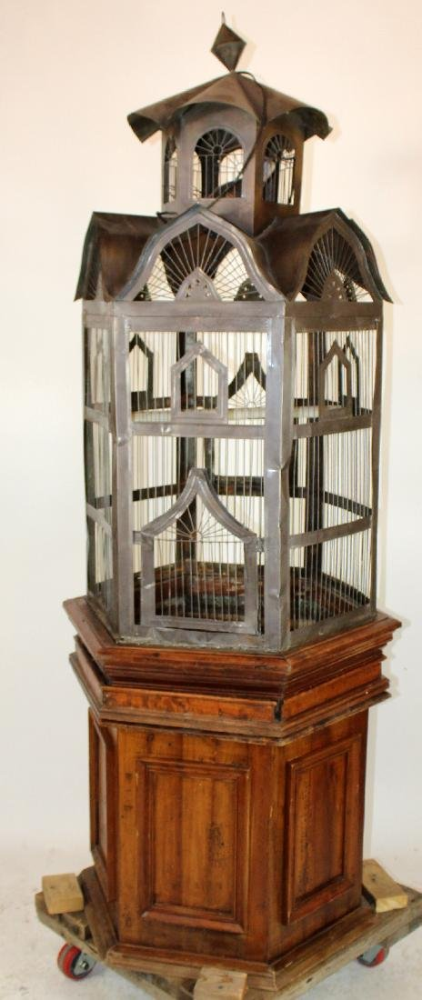 Ornate birdcage on cherry stand