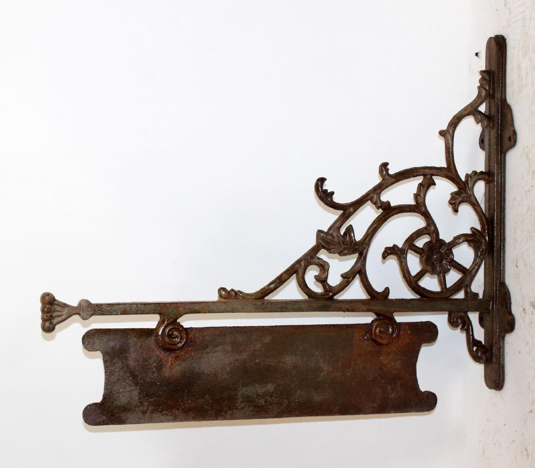 Rustic iron bracket sign