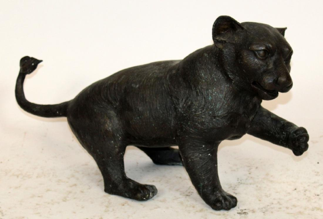 Bronze lion cub sculpture