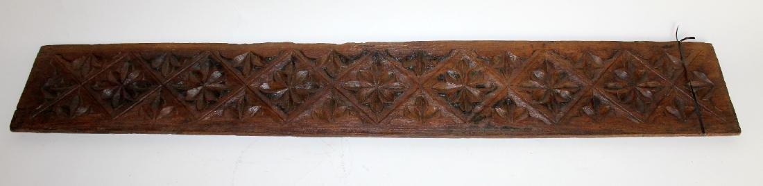 Carved teak panel with floral design
