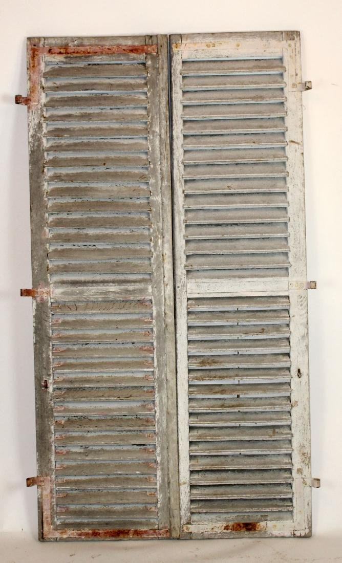 Pair of French painted wooden shutters