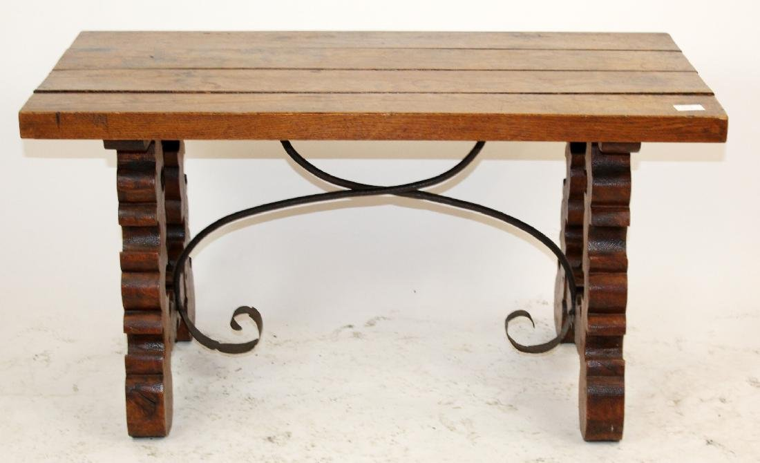 Spanish backless bench in oak with iron trestle