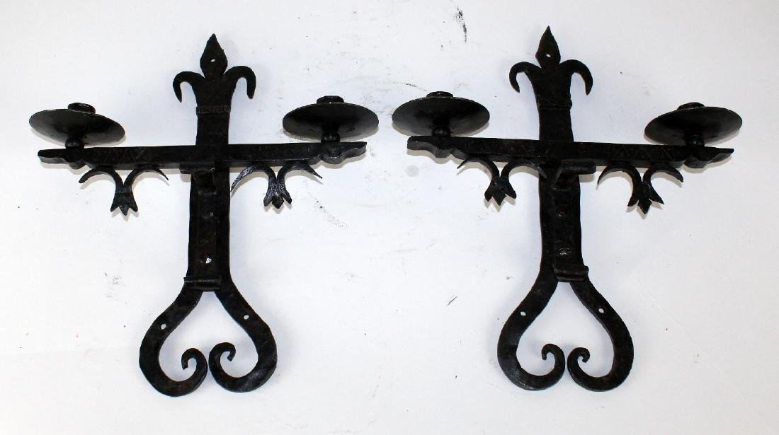 A pair of French iron 2-arm wall sconces