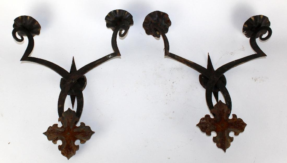 A pair of French iron wall sconces