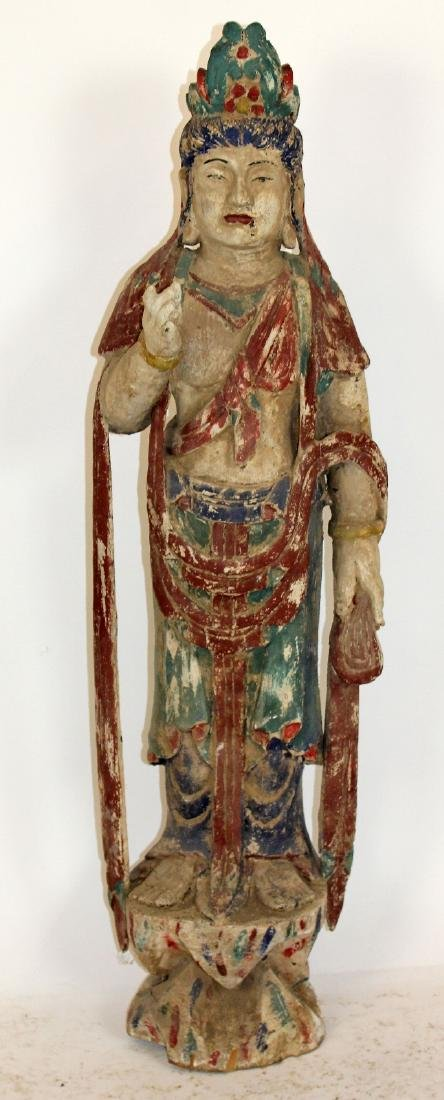 Carved wooden Chinese deity sculpture