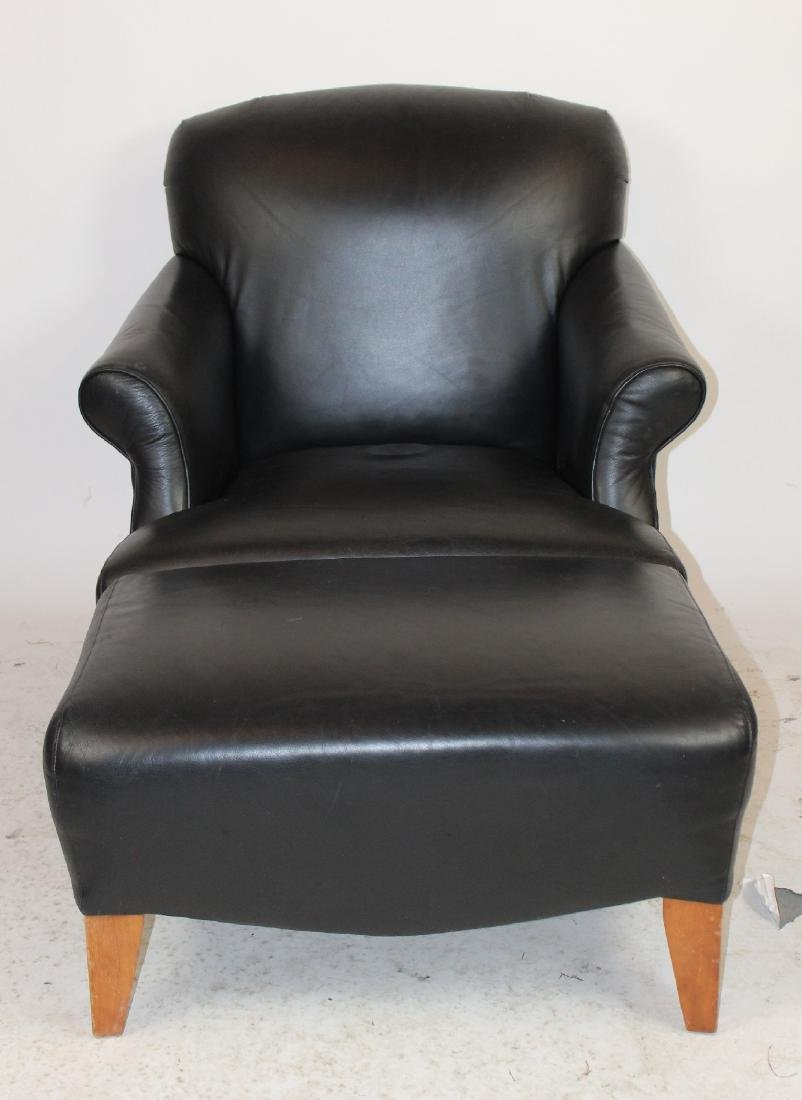 Black leather upholstered club chair and ottoman
