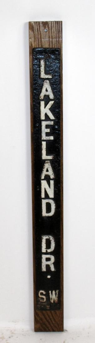 """Lakeland Dr"" painted iron street sign"