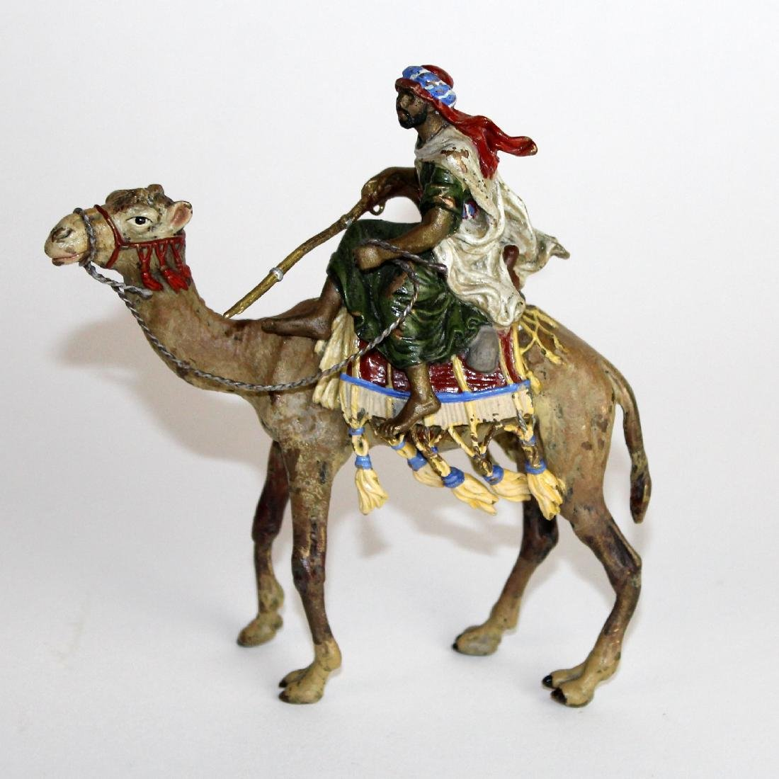 Cold painted bronze figurine of man on camel