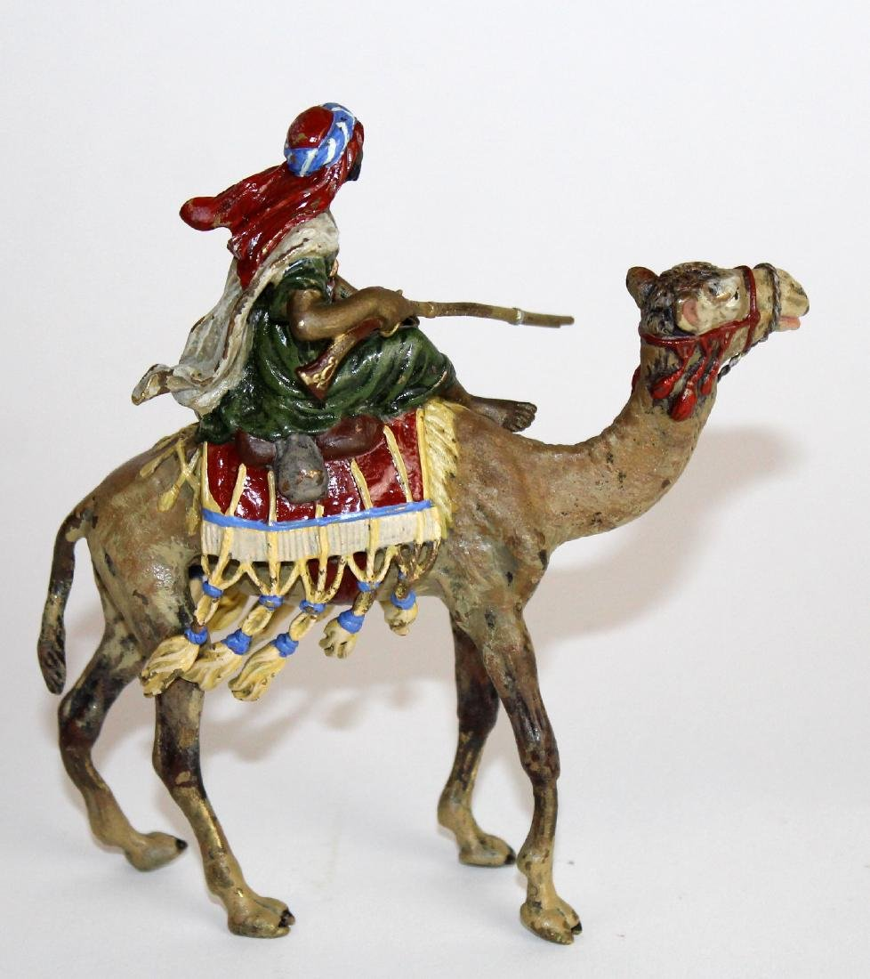Cold painted bronze figurine of man on camel - 2