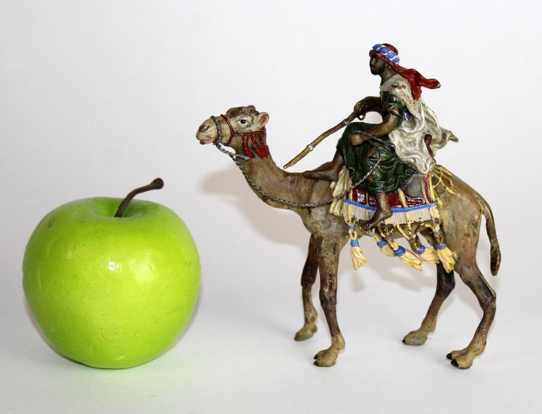 Cold painted bronze figurine of man on camel - 4