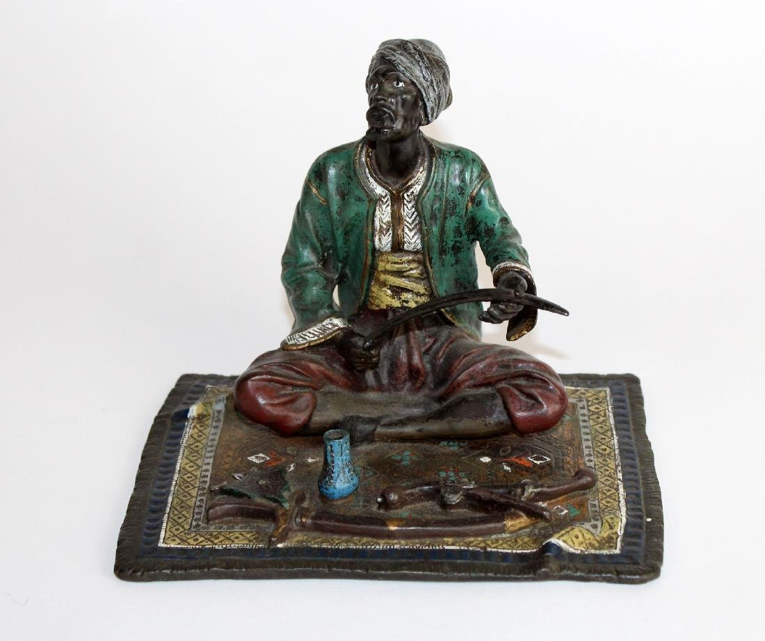 Cold painted bronze figurine of merchant