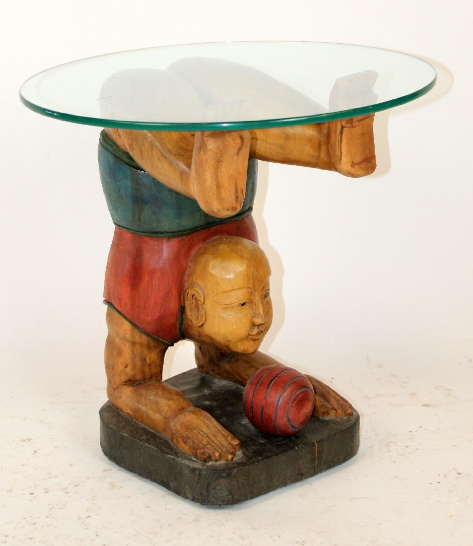 Figural carved glass top side table