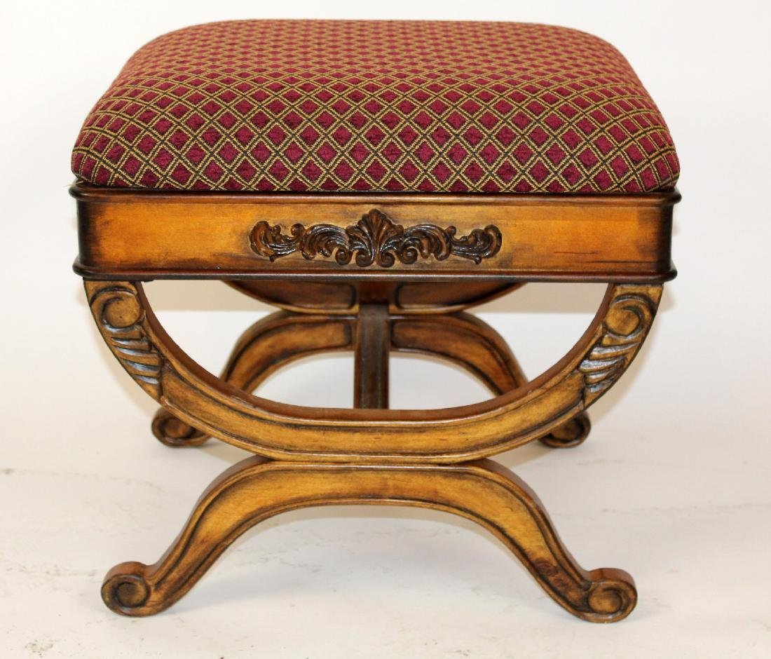 Upholstered ottoman with shaped legs
