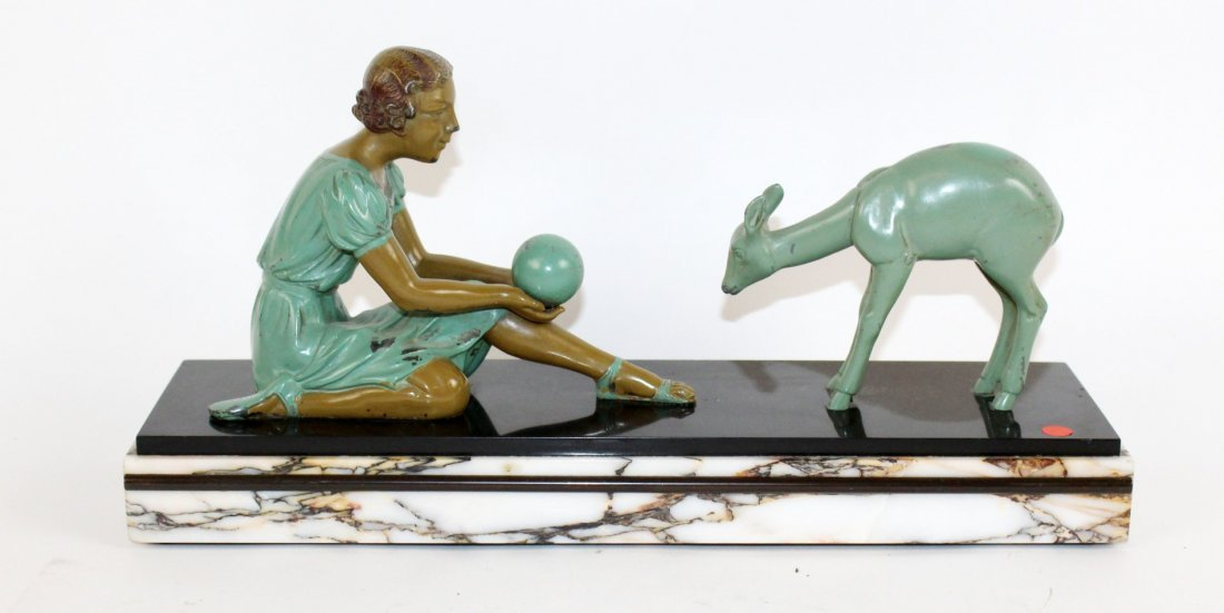 Art Deco depicting girl playing with deer