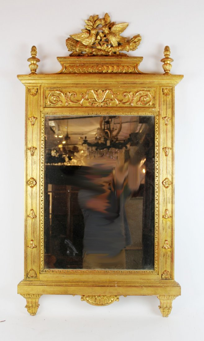 Gilt mirror with double lovebird crest