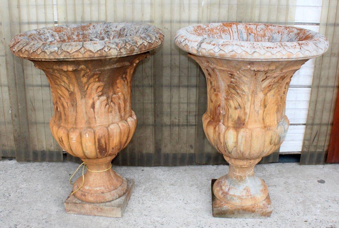 Pair of cast stone garden urns