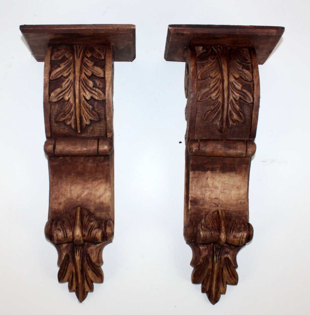Pair of carved wooden architectural corbels