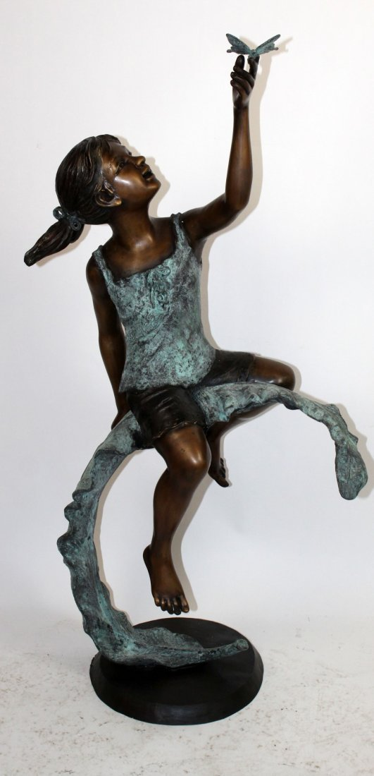 Bronze seated girl with butterfly