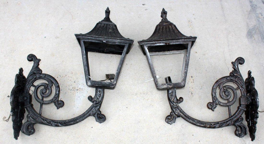 Pair of painted iron wall mount lanterns