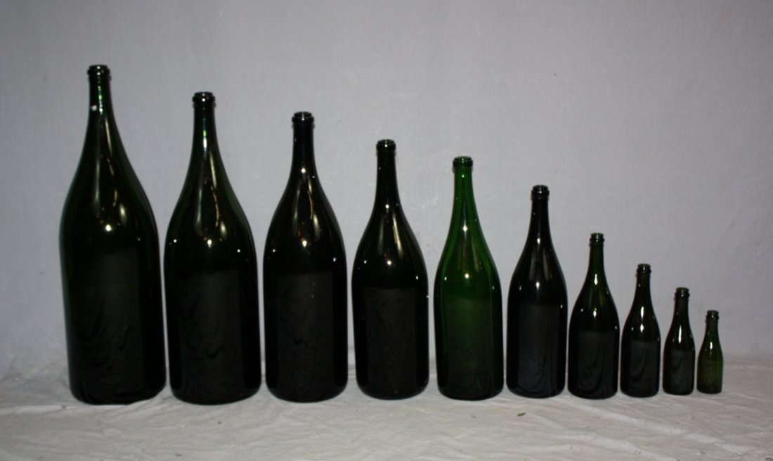 A set of 10 French blown glass wine bottles