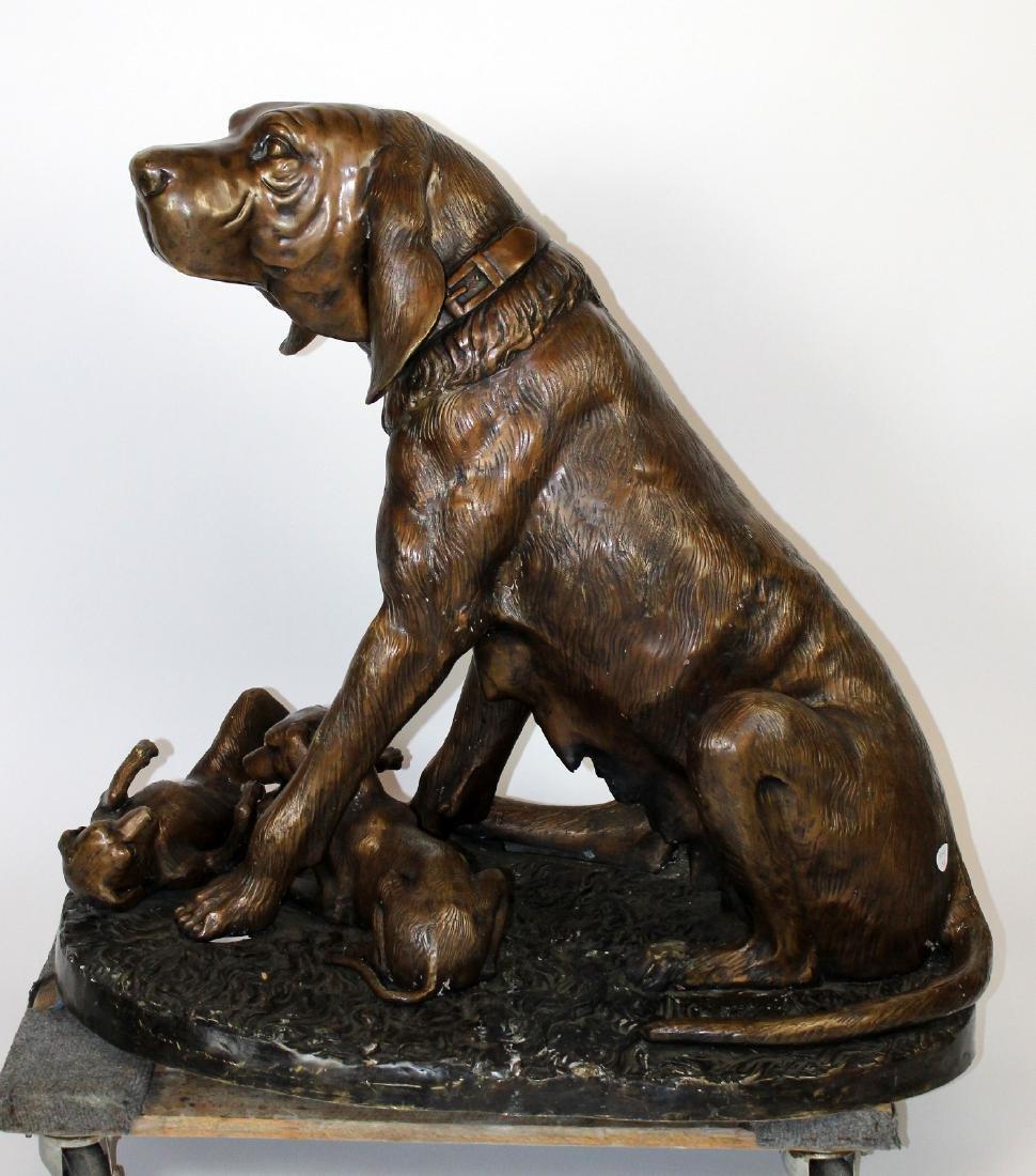 Bronze bloodhound statue with puppies