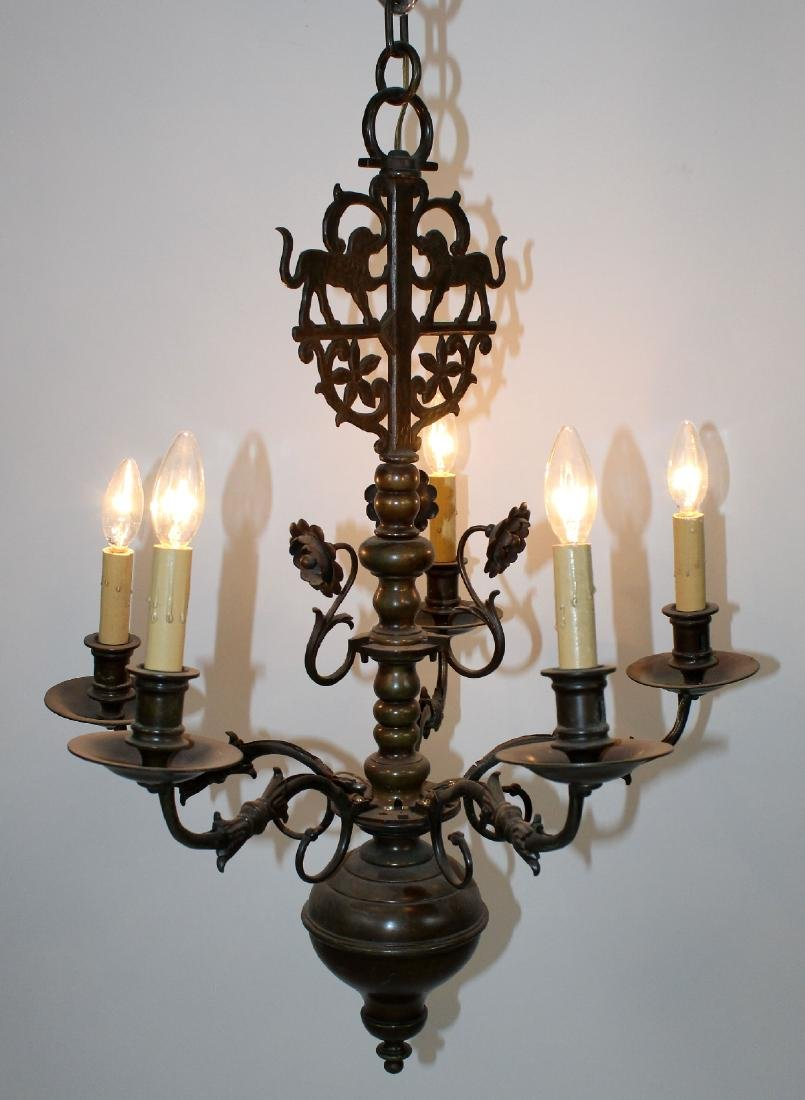 19th c. Dutch 6-arm chandelier in brass with dogs