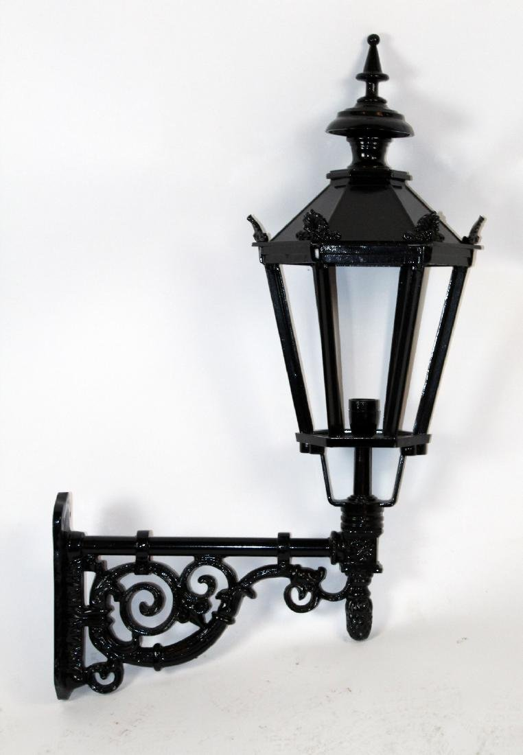 Single painted wall mount lantern style sconce