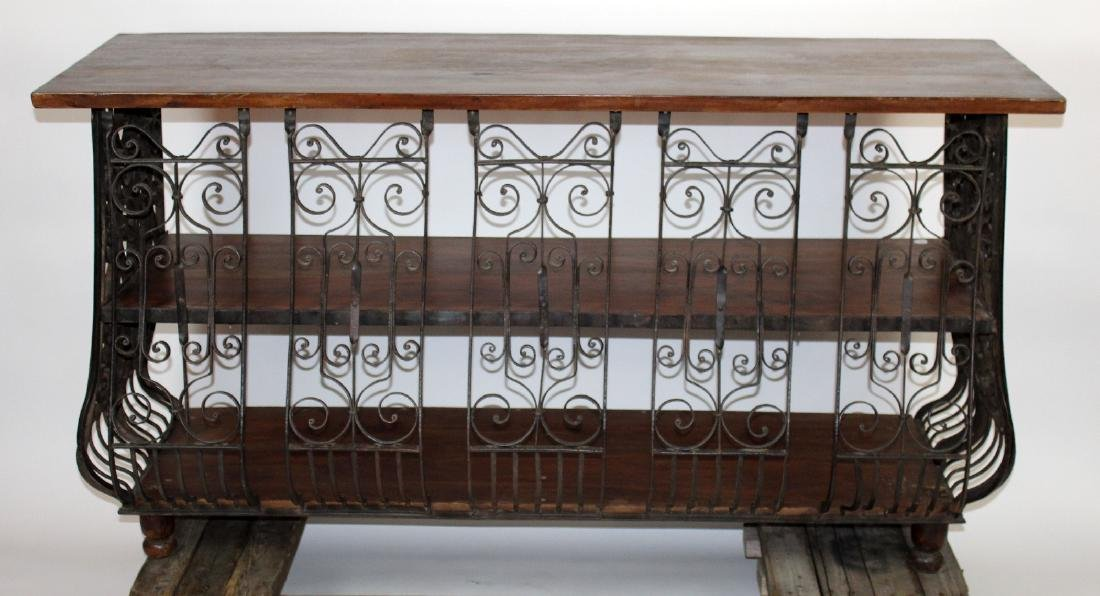 Scrolled iron console with rustic wood top