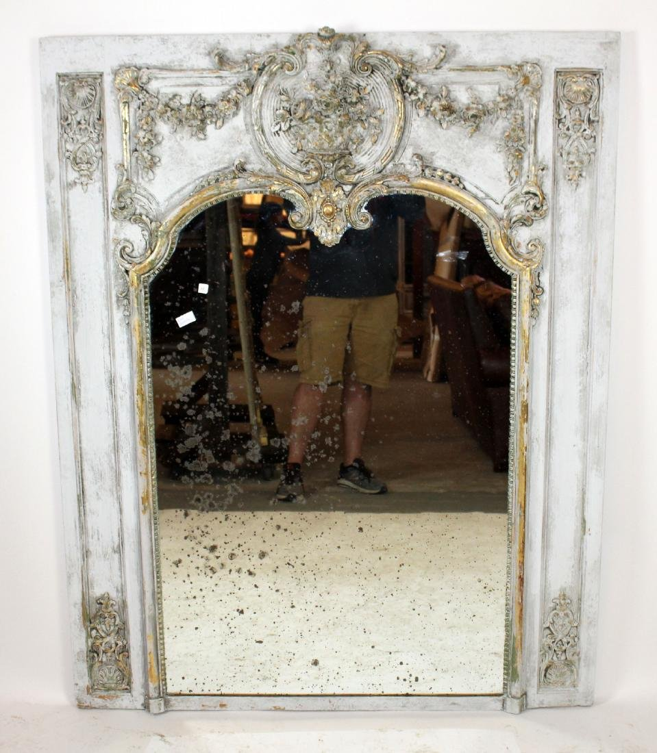 French Regency trumeau mirror with rose garland