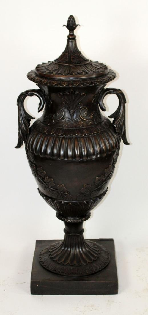 Classical bronze double handled lidded urn