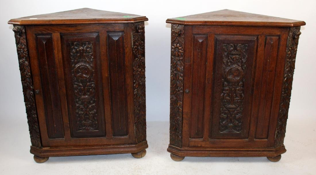 Pair of French corner cabinets in oak