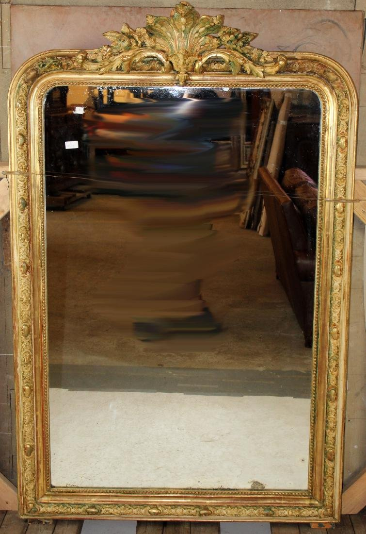French Louis XV gold leaf mirror with rocaille carving
