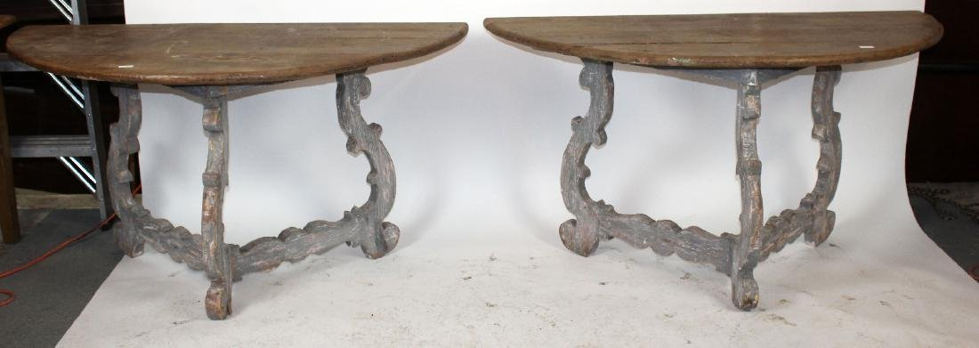 Pair of Italian shaped trestle demi lune consoles